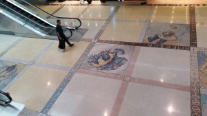 Names of continents and other texts in a DIA floor mosaic